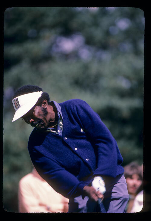 Calvin Peete staying down through impact on the tee during the 1982 NEC World Series of Golf