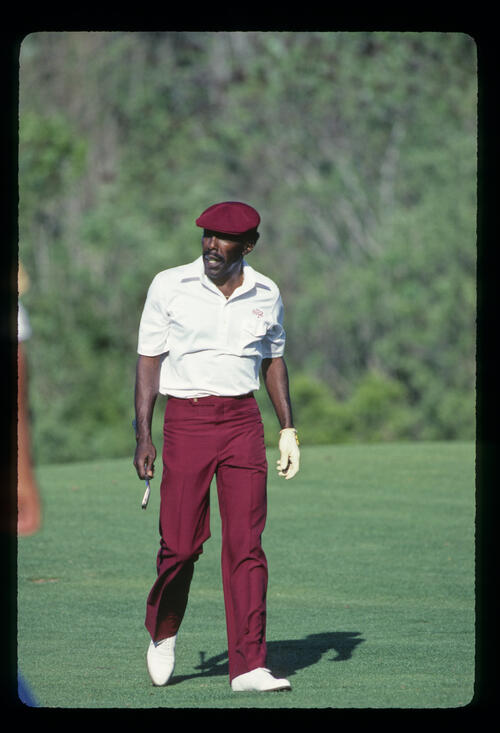Calvin Peete walking the fairway on his way to winning the 1985 TPC