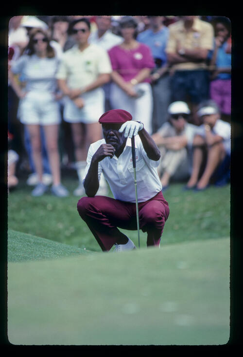 Calvin Peete lining up a putt on his way to winning the 1985 TPC