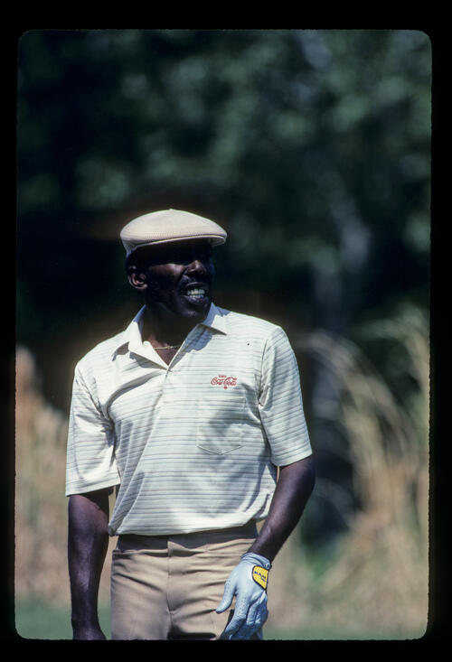 Calvin Peete watching his shot closely on his way to winning the 1985 TPC