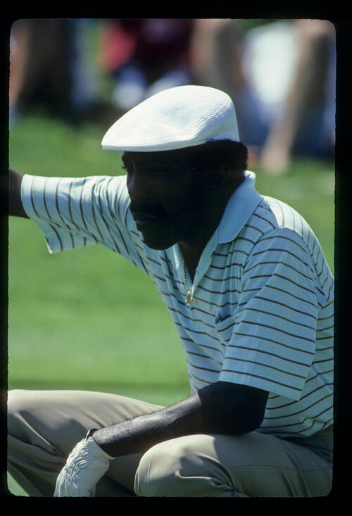 Calvin Peete lining up a putt during the 1983 USPGA