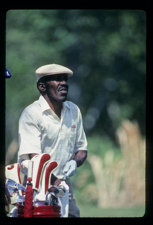Calvin Peete making a club selection on his way to winning the 1985 TPC