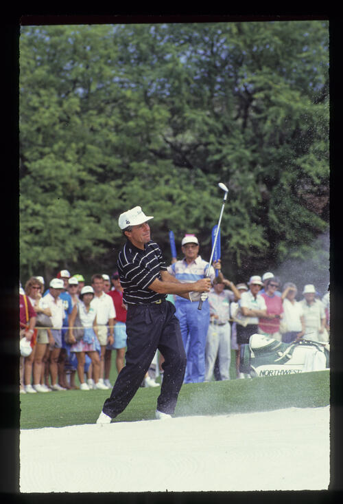 Gary Player with an awkward bunker shot during the 1990 Senior Skins Game
