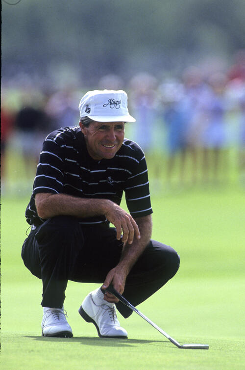 Gary Player smiling as he lines up a putt during the 1990 Senior Skins Game