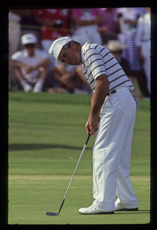 Gary Player watching his putt closely during the 1990 Senior Skins Game