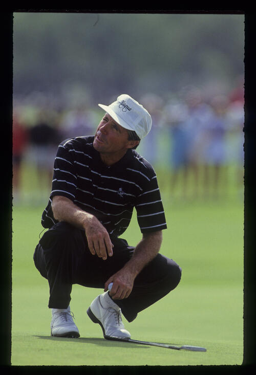 Gary Player chatting while lining up a putt during the 1990 Senior Skins Game