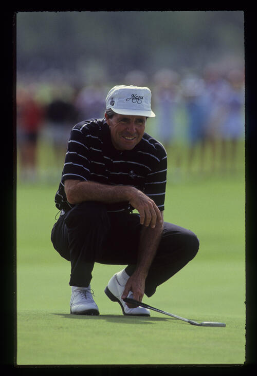 Gary Player smiling while lining up a putt during the 1990 Senior Skins Game