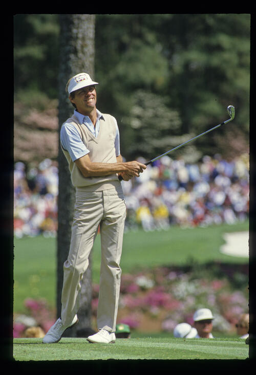 Bill Rogers watching his tee shot closely during the 1986 Masters