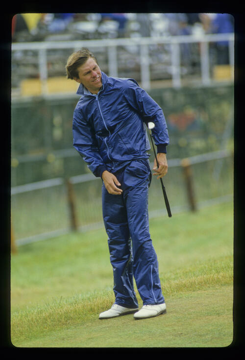 Bill Rogers putting in waterproof gear during the 1985 Open Championship