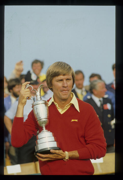 A victorious Bill Rogers holding the Claret Jug aloft after winning the 1981 Open Championship