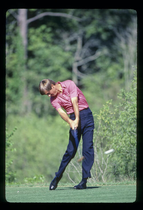 Bill Rogers powering through a drive during the 1985 TPC