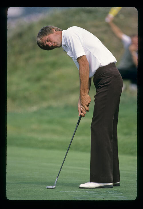 Bill Rogers sending a putt on its way during the 1983 Open Championship