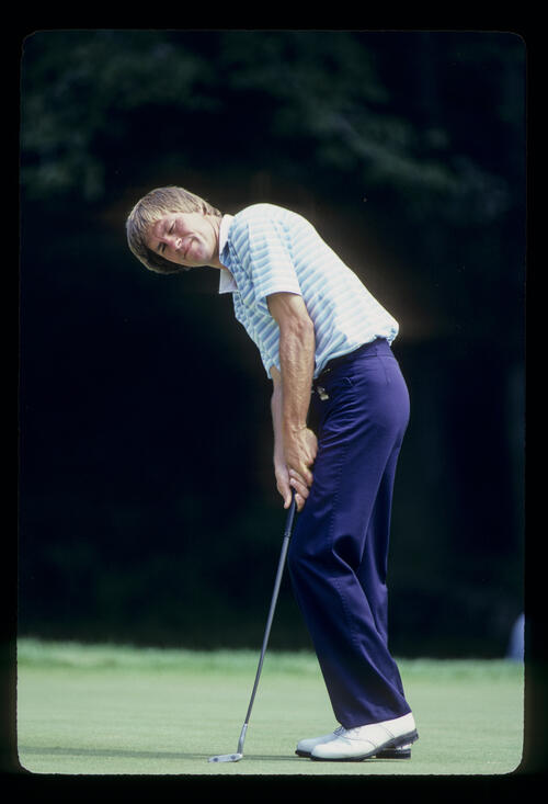 Bill Rogers grimacing after a putt during the 1981 US Open