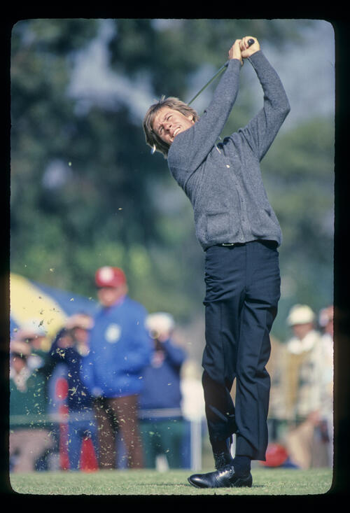 Bill Rogers hands high on the tee during the 1982 San Diego Open