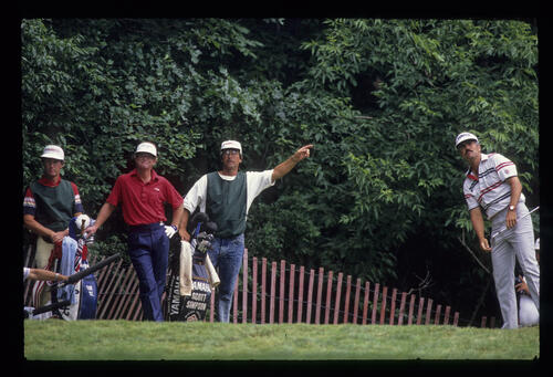 Scott Simpson's caddie shouting 'fore left' as Tom Kite looks on during the 1989 US Open