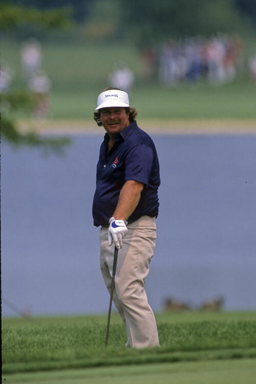 Craig Stadler smiling from the greenside rough during the 1989 USPGA