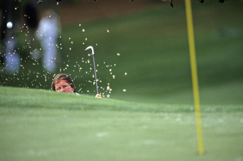 Craig Stadler splashing from a very deep bunker during the 1989 Masters