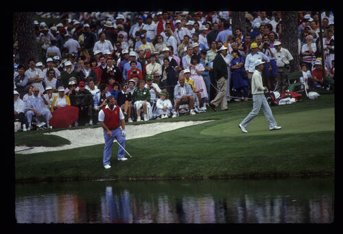 Craig Stadler after retrieving it from the water during the 1989 Masters
