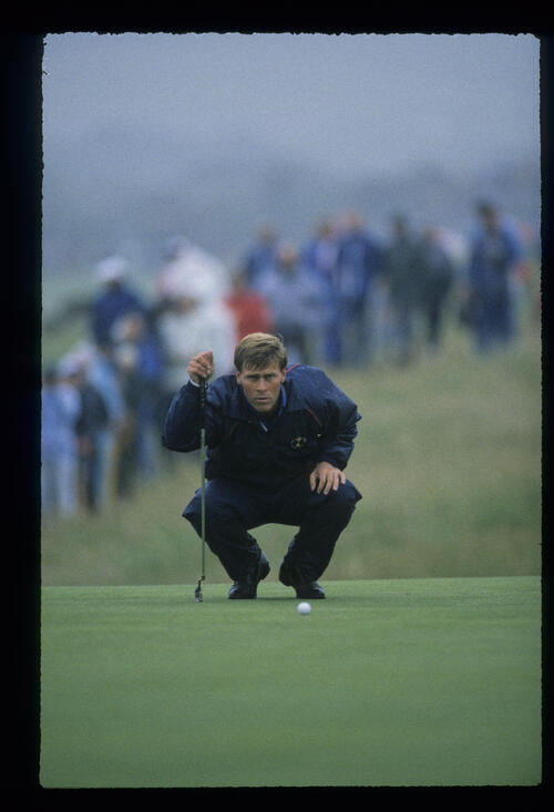 Hal Sutton lining up a putt in the rain during the 1987 Open Championship
