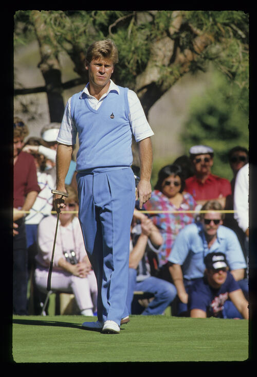 Hal Sutton watching his putt closely during the 1987 TPC