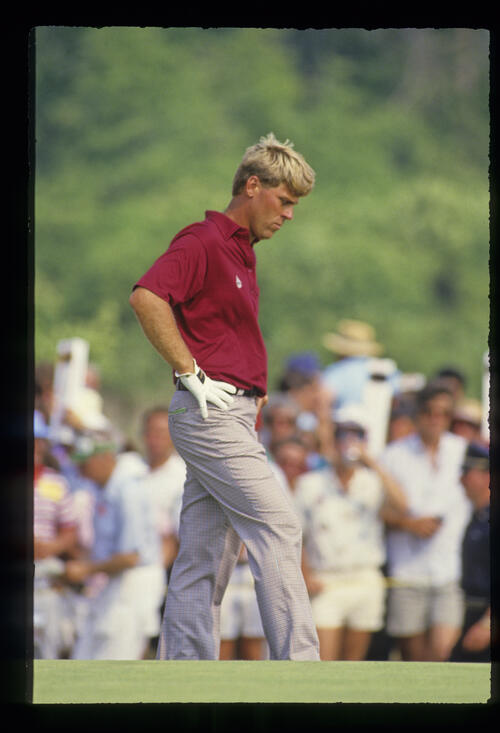 Hal Sutton looking thoughtful with hands on hips during the 1986 US Open