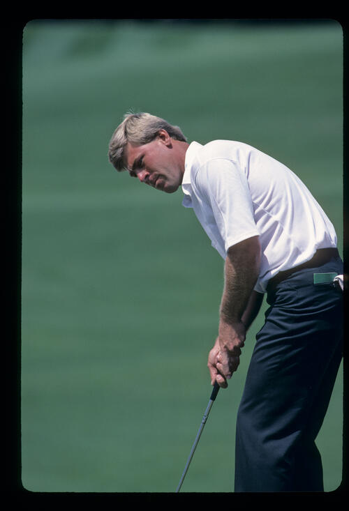 Hal Sutton sending a putt on its way during the 1985 Masters