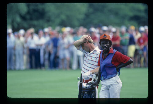 Hal Sutton and his caddie considering their options on the fairway during the 1984 US Open
