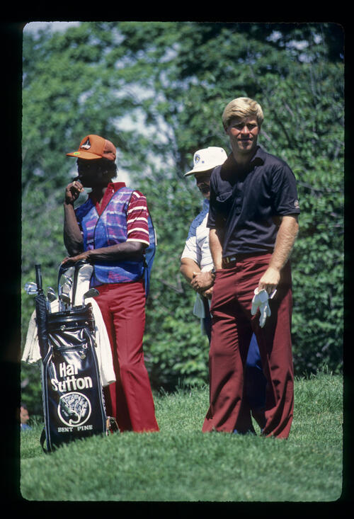 Hal Sutton and his caddie considering their options in the rough during the 1984 US Open