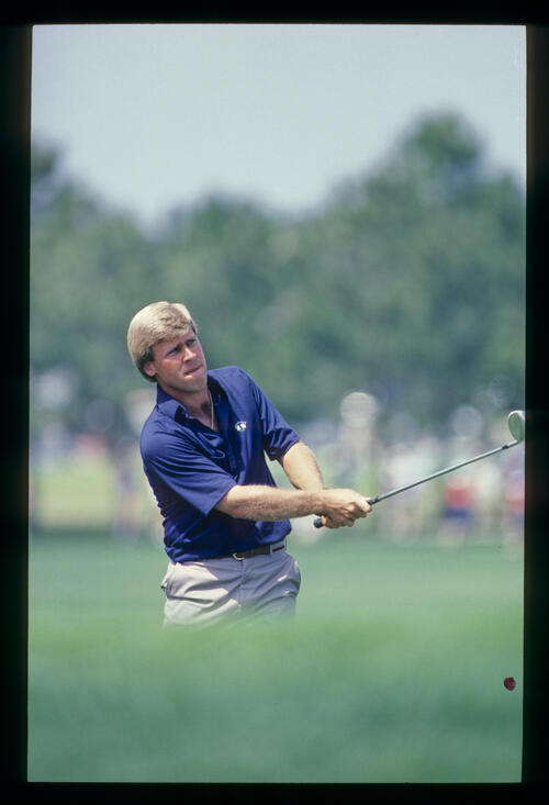 Hal Sutton watching closely after his drive during the 1984 TPC