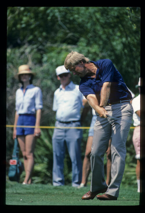 Hal Sutton staying down through the ball while driving during the 1984 TPC