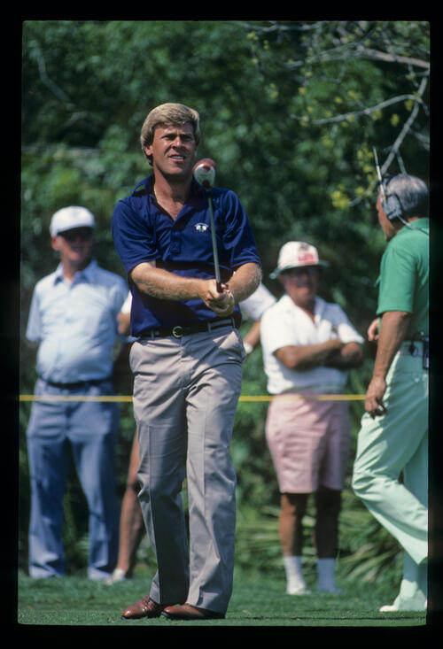 Hal Sutton watching closely after driving during the 1984 TPC