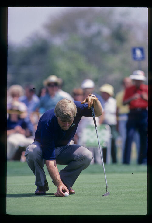 Hal Sutton replacing his ball on the green during the 1984 TPC