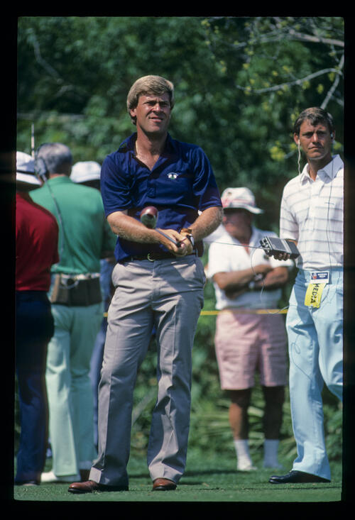 Hal Sutton watching the result of his drive during the 1984 TPC