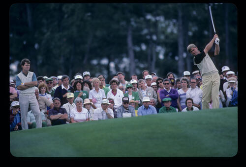Hal Sutton hands high on the tee in front of the gallery during the 1985 Masters