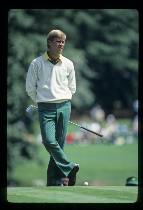 Hal Sutton with legs crossed, waiting his turn on the tee during the 1984 Masters