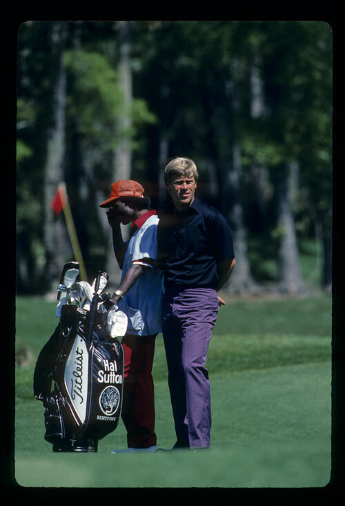 Hal Sutton and his caddie considering their options on the fairway during the 1984 TPC