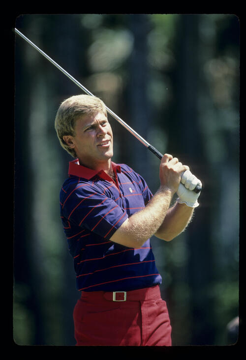 Hal Sutton watching his tee shot closely during the 1984 TPC