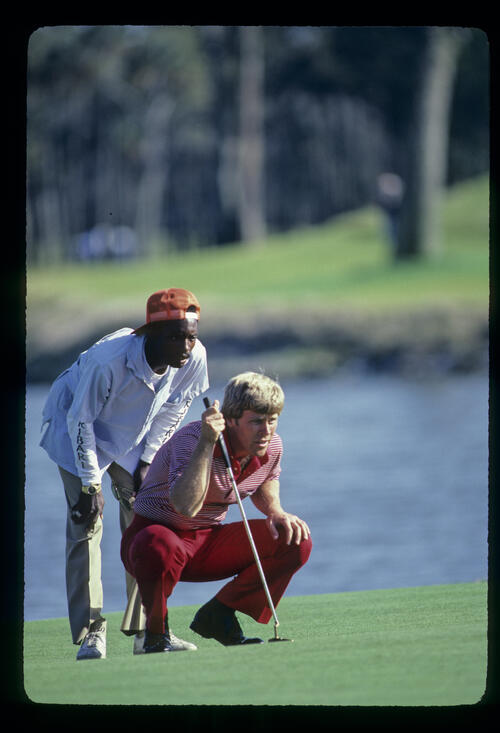 Hal Sutton and his caddie considering a putt on his way to winning the 1983 TPC