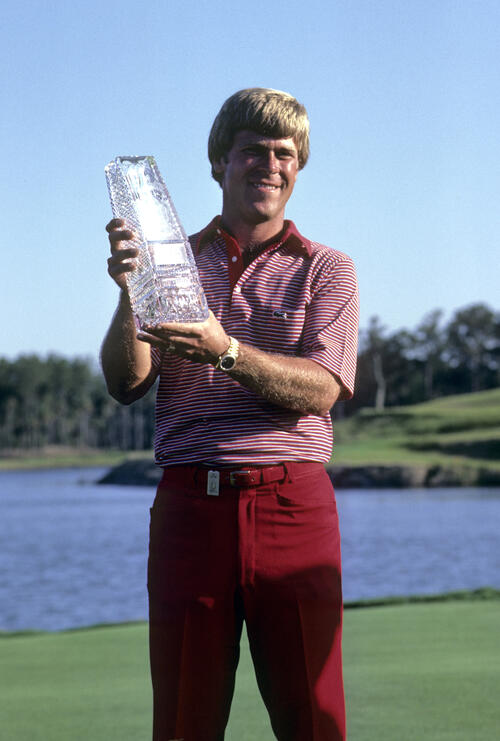 Hal Sutton smiling with the trophy after winning the 1983 TPC