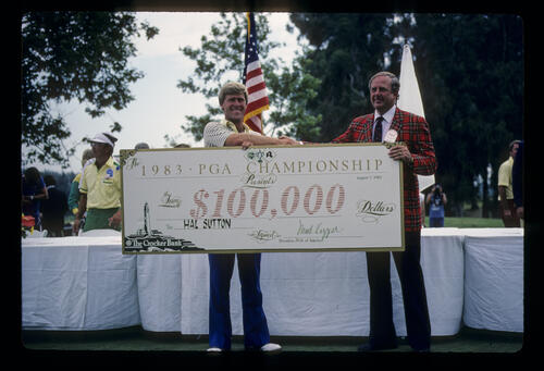 Hal Sutton receiving a large cheque after winning the 1983 USPGA