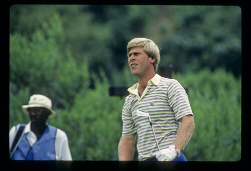 Hal Sutton and his caddie on his way to winning the 1983 USPGA