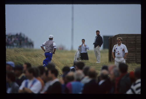 Payne Stewart jogging through the rough to the toilets during the 1993 Open Championship.