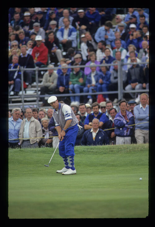 Payne Stewart waiting for his putt to drop during the 1993 Open Championship.