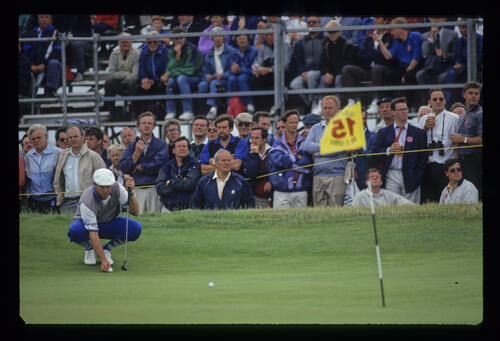 Payne Stewart squatting to line up a putt during the 1993 Open Championship.