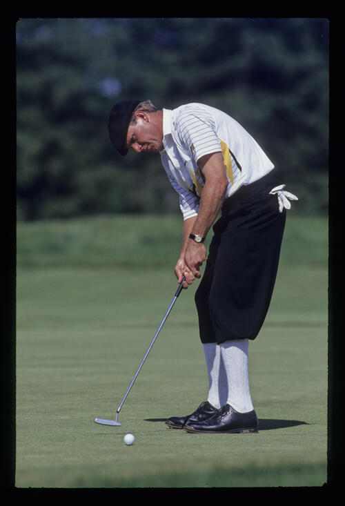 Payne Stewart sending a putt on its way during the 1993 US Open