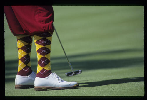 The distinctive plus-fours and stockings of Payne Stewart as he putts during the 1993 TPC