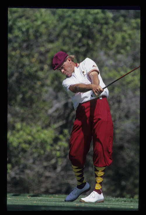 Payne Stewart extending through a drive during the 1993 TPC