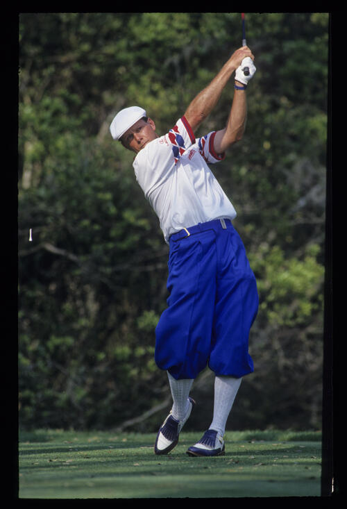 Payne Stewart extending through the ball after a drive during the 1993 TPC