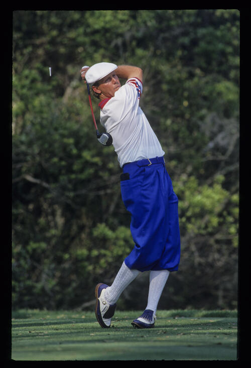 Payne Stewart following through after a drive during the 1993 TPC