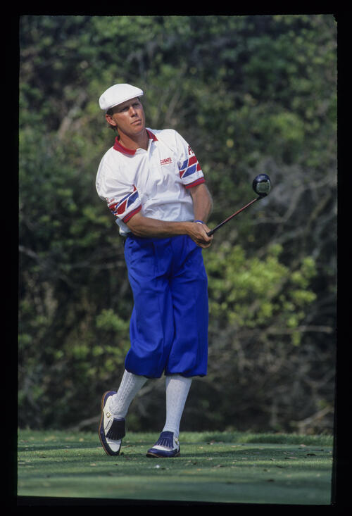 Payne Stewart watching his ball closely after a drive during the 1993 TPC